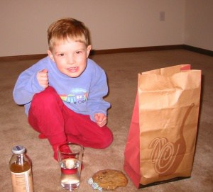 Ben and I sitting down for Pesto Cavatappi in our new empty apartment years ago.