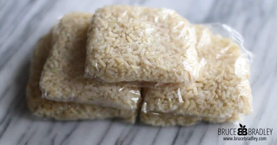 To freeze brown rice portion it out into squares of plastic wrap to make rice squares. Date the squares and put them in a freezer bag and store in the freezer!