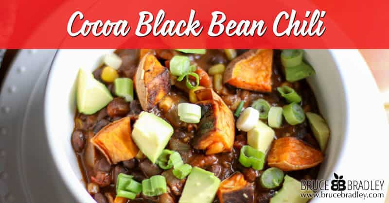 This Cocoa Black Bean Chili recipe is super easy and made with black beans, cocoa, and sweet potatoes. Seriously, it's so delicious and hearty nobody will know it's vegan!